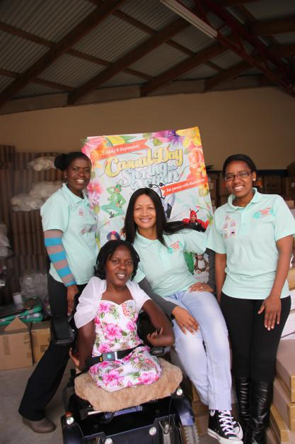 Back Casual Day staff in mint - Egness Ncube Zaza Khazamula and Sekai Marufu with Casual Day ambassador Prudence Mabena