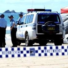Surfer 'swam to shore after losing arm'