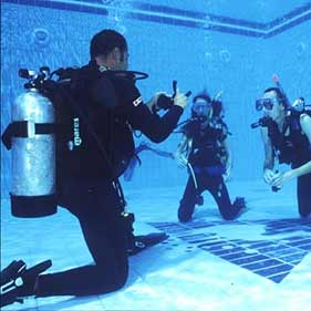 Scuba divers in a pool